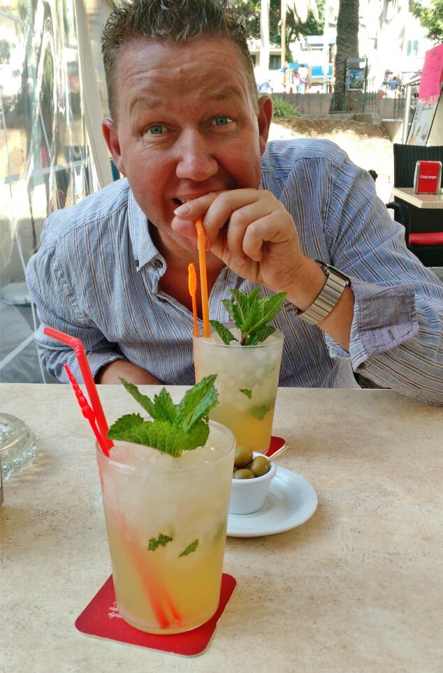 Ian drinking a mojito through a straw