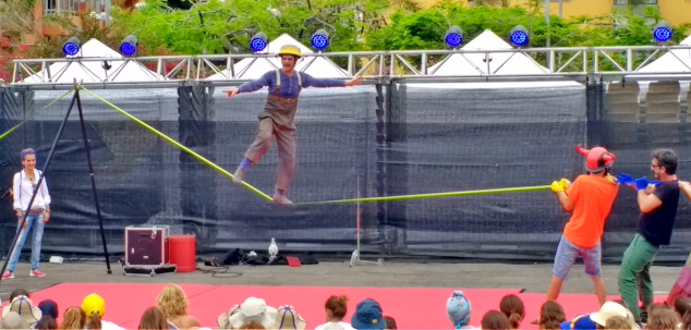 A clown balancing on a tightrope at Festival Mueca