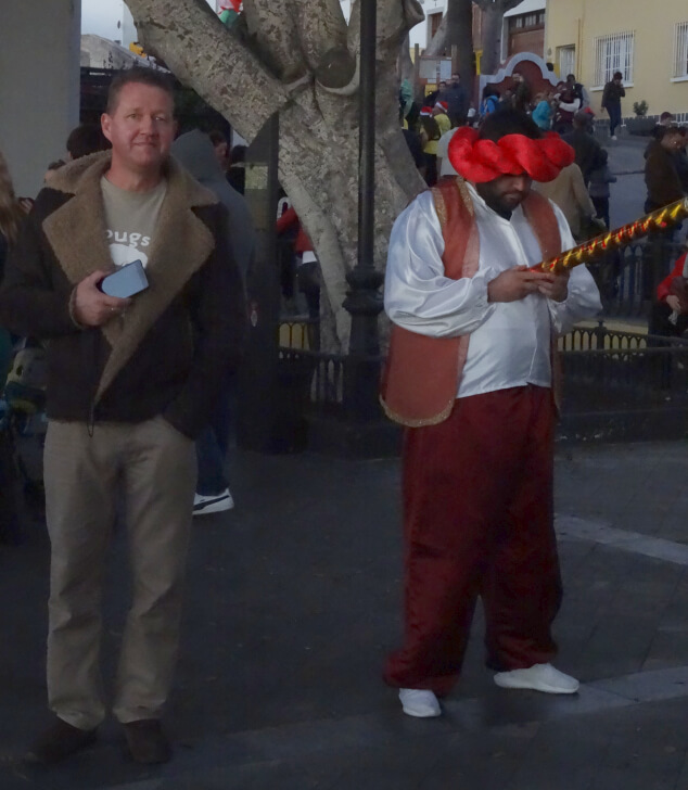 Two men stood at the Kings' Day Parade in San Miguel