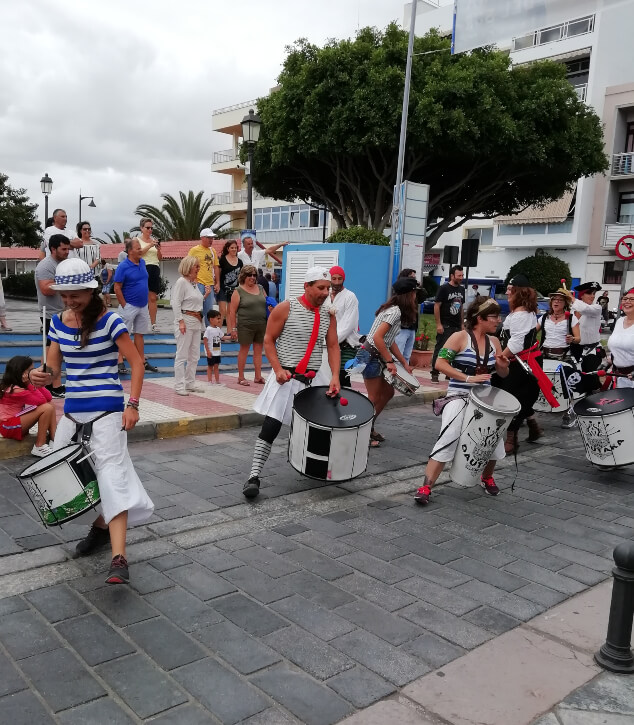 People playing drums in the street