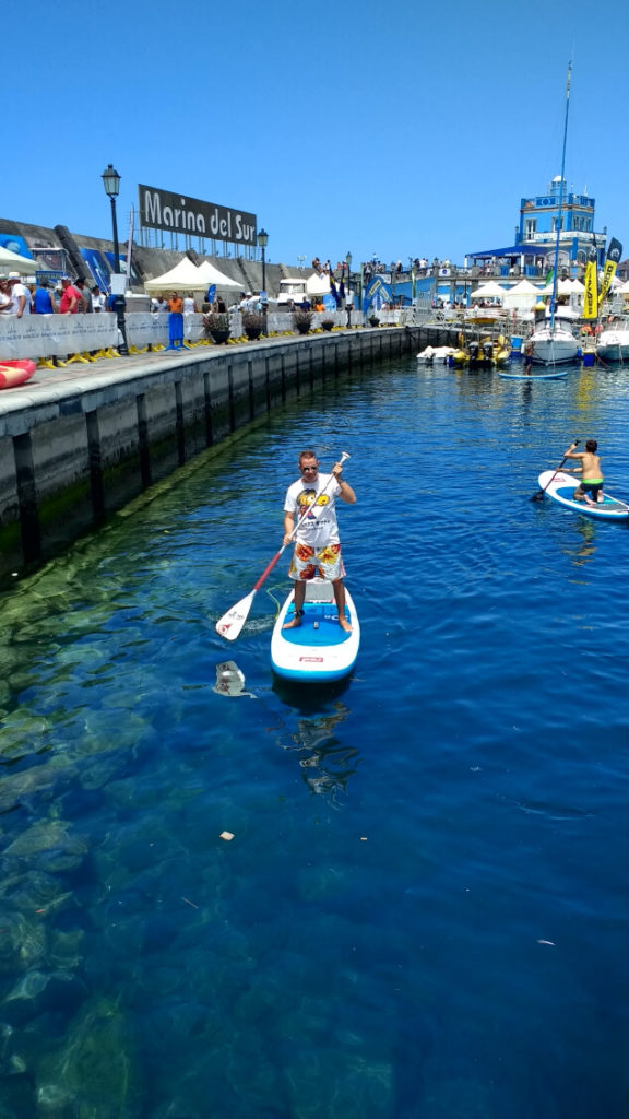 A man on a stand up paddle board in the sea