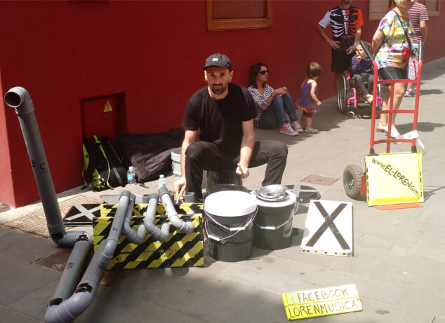 A drummer performing with recycled materials at Festival Mueca