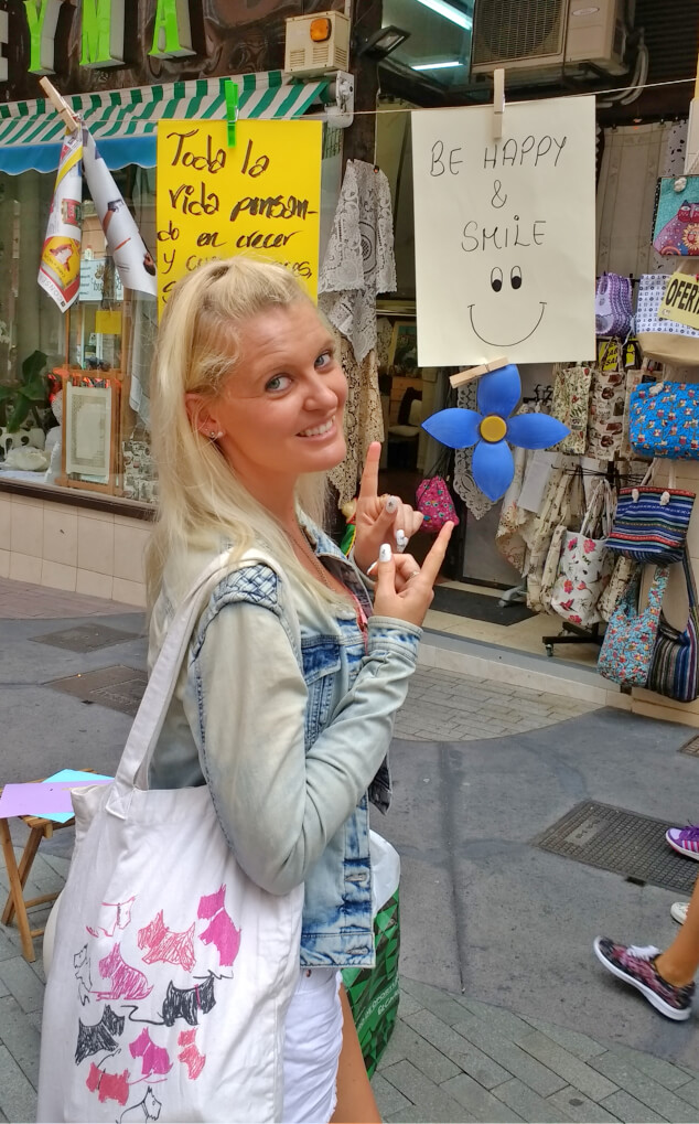 Nicky pointing to a sign at Festival Mueca