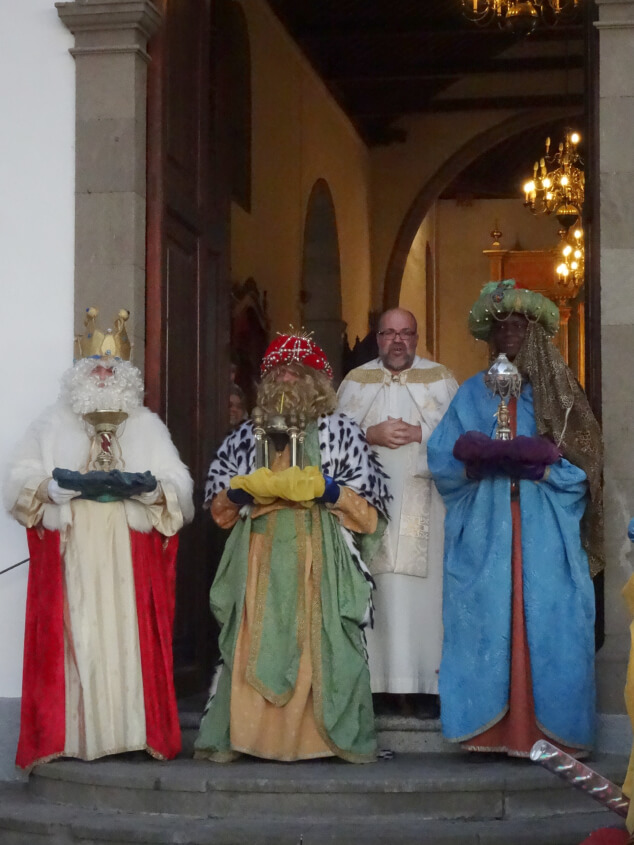 Three kings stood outside a church at the Kings' Day Parade in San Miguel, Tenerife