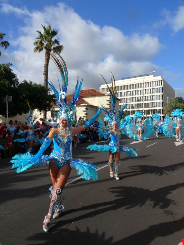 Women in beautiful blue dresses dancing at the Santa Cruz carnival