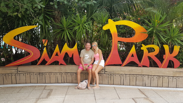 Two people sat in front of a sign at Siam Park in Tenerife